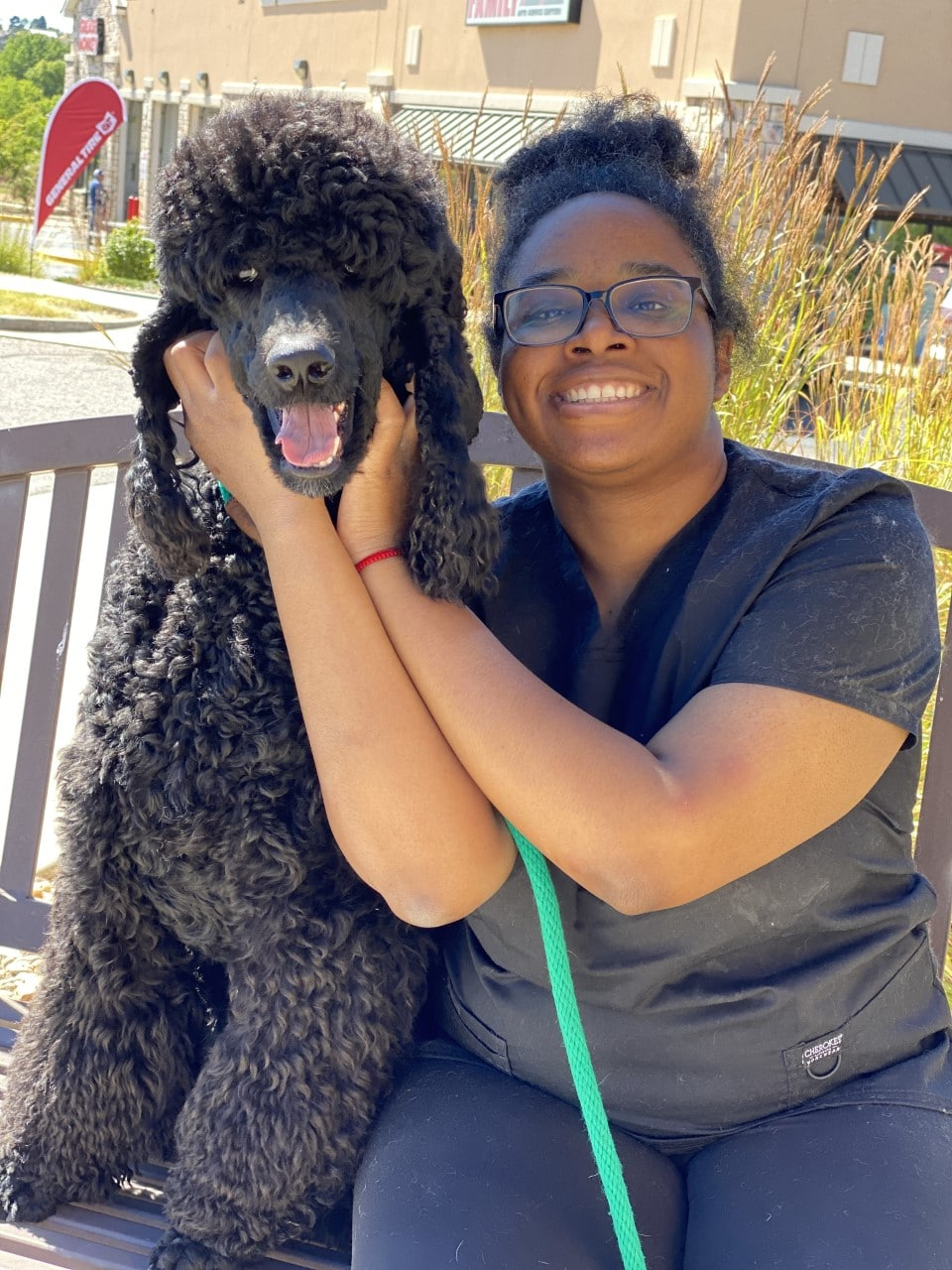 Woman with Black Poodle